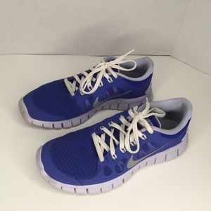 Nike white and blue sneakers.